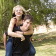 Stock Photo: Happy piggyback girl on back