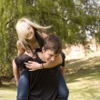 Stock Photo: Piggyback girl on back