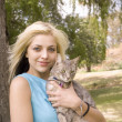 Stock Photo: Portarit of womor girl with cat