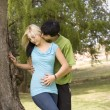Kissing neck nest to garden tree — Stock Photo