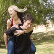 Stock Photo: Smiling piggyback girl on back