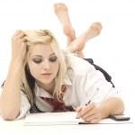 Pretty teenage girl doing homework — Stock Photo