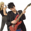 Woman singer and male guitarist in foreground — Stock Photo
