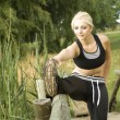 Stock Photo: Woman runner stretching