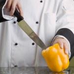 Chef Cutting Yellow Pepper — Stock Photo