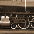 Steam locomotive close up in sepia — Stock Photo