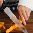 Stock Photo: Slicing carrot
