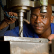 African American with drill press — Stock Photo #18236131