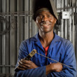 African welder with mask - Stock Photo