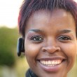 Businesswoman with bluetooth headset — Stock Photo