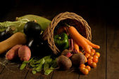 Basket filled with fruit and vegetables — Stock Photo