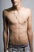 Young man with lean stomach muscles — Stock Photo