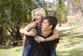 Looking piggyback girl on back — Stock Photo