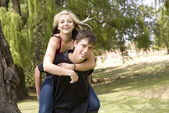 Happy piggyback girl on back — Stock Photo