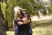 Piggyback girl on back — Stock Photo