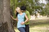Kissing neck nest to garden tree — Stock Photo