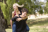 Smiling piggyback girl on back — Stock Photo