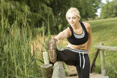 Woman runner stretching — Stock Photo