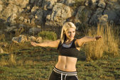 Stretching Tai Chi woman in park — Stock Photo