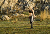 Woman exercise stretching leg in park — Foto de Stock