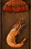 Crayfish tail and prawn on table — Stock Photo