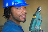 Worker and drill — Stock Photo