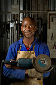 African American with angle grinder — Stock Photo