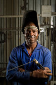 African welder with mask — Stock Photo