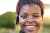 Businesswoman with bluetooth headset — Stok fotoğraf