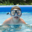 Stock Photo: Boy in pool with diving mask