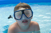 Boy in pool with diving mask — Stock Photo