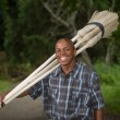 Stock photograph of South African entrepreneur small business broom salesman - Stock Photo