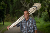Stock photograph of South African entrepreneur small business broom salesman — Stockfoto