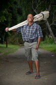 Stock photograph of South African entrepreneur small business broom salesman — Foto de Stock