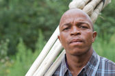 Stock photograph of a worried South African entrepreneur small business broom salesman — Stock Photo