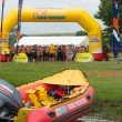 Surf rescue water life saving infatable boat with 2013 Midmar Mile swimmers in background — Stock Photo
