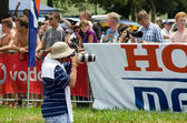 Photographer or photo journalist captures images at the 2013 Midmar Mile swimming event, South Africa — Stock Photo