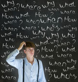 Thinking business man with chalk questions what why when where who and how — Stock Photo