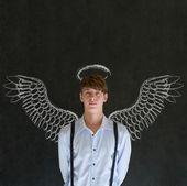 Hombre de negocios ángel inversionista con tiza alas y halo — Foto de Stock