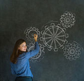 Woman thinking with turning gear cogs or gears — Stock Photo