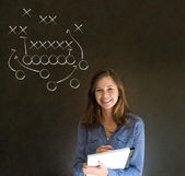 Woman with American football strategy on blackboard — Stock Photo