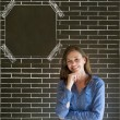 Business woman, student or teacher on brick wall notice board blackboard background — Stock Photo