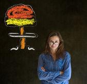 Woman thinking chalk nuclear bomb cloud blackboard background — Stock Photo