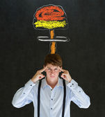 Man thinking chalk nuclear bomb cloud blackboard background — Stockfoto