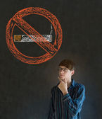 No smoking tobacco man on blackboard background — Stock Photo