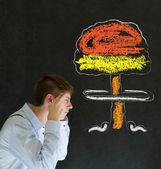 Man thinking chalk nuclear bomb cloud blackboard background — Stock Photo