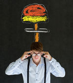 Man thinking chalk nuclear bomb cloud blackboard background — Stock Photo