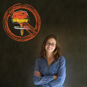 No nuclear war pacifist business woman, student, teacher or politician on blackboard background — Stock Photo