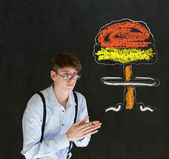 Evil or sneaky man thinking chalk nuclear bomb cloud blackboard background — Stock Photo