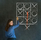 Thinking out of the box woman on blackboard background — Stock Photo